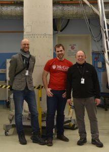 Andrew Higgins, left, Jan Palecka, and Samuel Goroshin of McGill University stand with the payload stage of the European Space Agency MAXUS-9 sounding rocket.